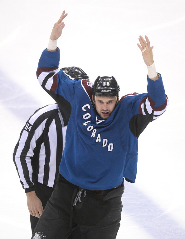 . Patrick Bordeleau encouraged the fans as he skated to the penalty box after a fight in the second period. The Colorado Avalanche hosted the Vancouver Canucks Thursday night, March 27, 2014 at the Pepsi Center in Denver, Colorado. (Photo by Karl Gehring/The Denver Post)
