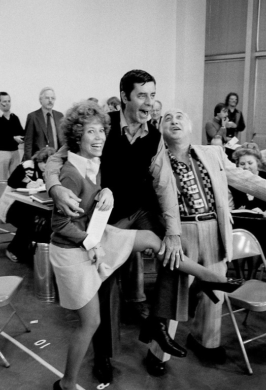 . Jerry Lewis, center, Jill Choder, left, and Joey Faye ham it up during rehearsal for revival of Hezlzaioti, Monday, Oct. 25, 1976, New York.  (AP Photo/Marty Lederhandler)