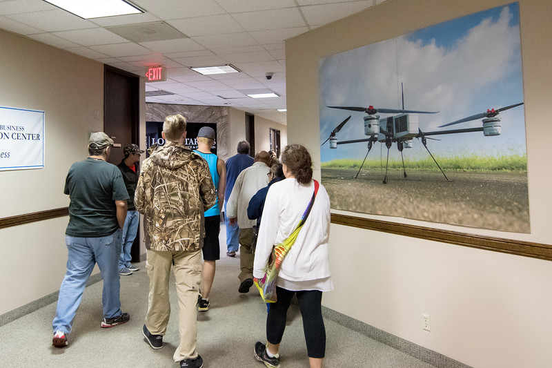 A group of guests make their way to the Lone Star UAS Command Center during a tour. Saturday March 04, 2017 during the Drone Expo.