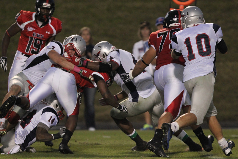 Kenny Little (6) pushes through another tackle