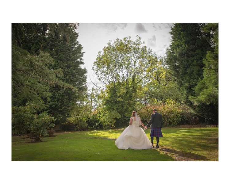 Wedding Photography of Paula & Fraser, Dunmar House, Alloa, Photograph is of the Bride & Groom in the gardens