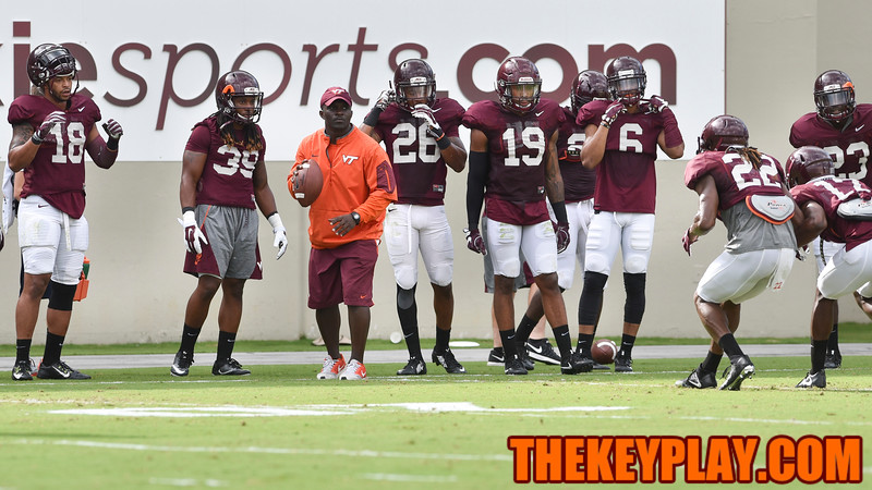 Safeties coach Galen Scott prepares to throw during a practice drill for the defensive backs. (Michael Shroyer/ TheKeyPlay.com)