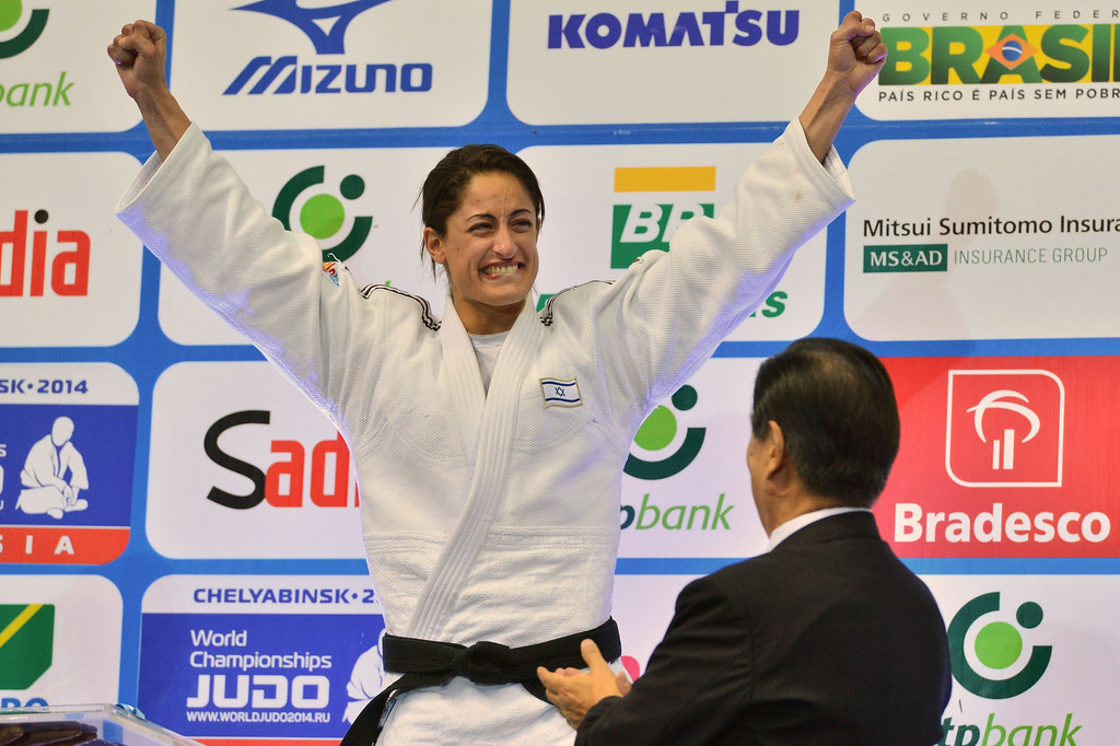 . Israel\'s gold medallist Yarden Gerbi celebrates on the podium during the medal ceremony for the women\'s -63kg category, during the IJF World Judo Championship, in Rio de Janeiro, Brazil, on August 29, 2013. YASUYOSHI CHIBA/AFP/Getty Images