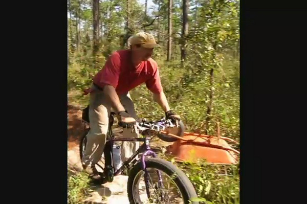 This vid and the next five photos were from what's depicted as #015 on the map. Ken and Foster checks trail flow on the Pugsley. Wunderdog Boo Foster approves. Jim Schmid heads back with some stray tools.