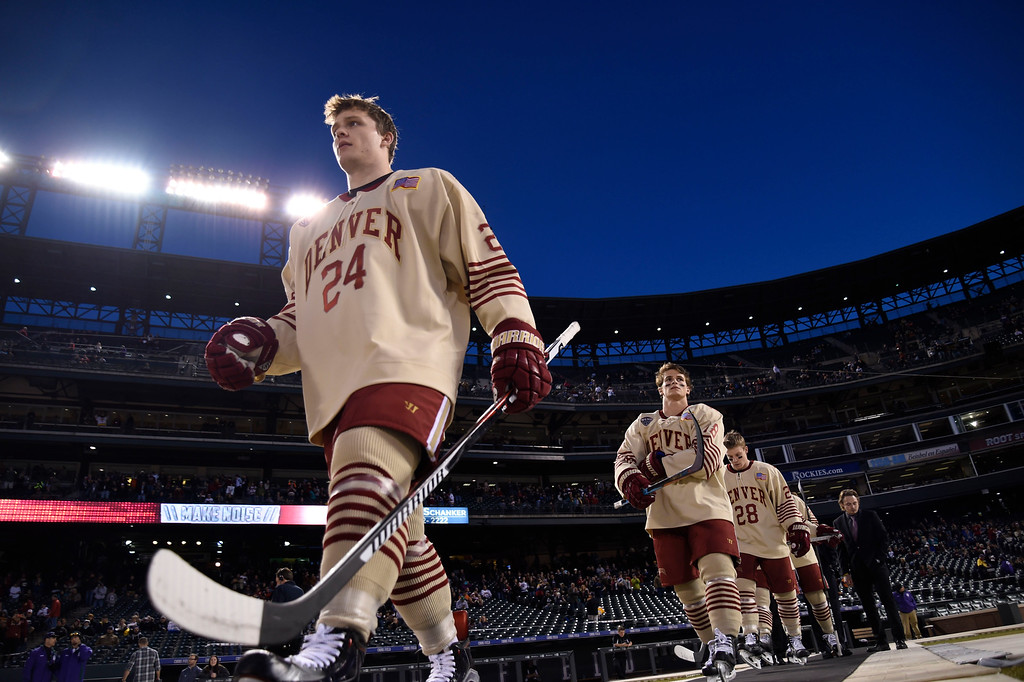 . Denver Pioneers forward Colin Staub (24) heads to the ice to take on Colorado College during the Battle On Blake February 20, 2016 at Coors Field.  (Photo By John Leyba/The Denver Post)