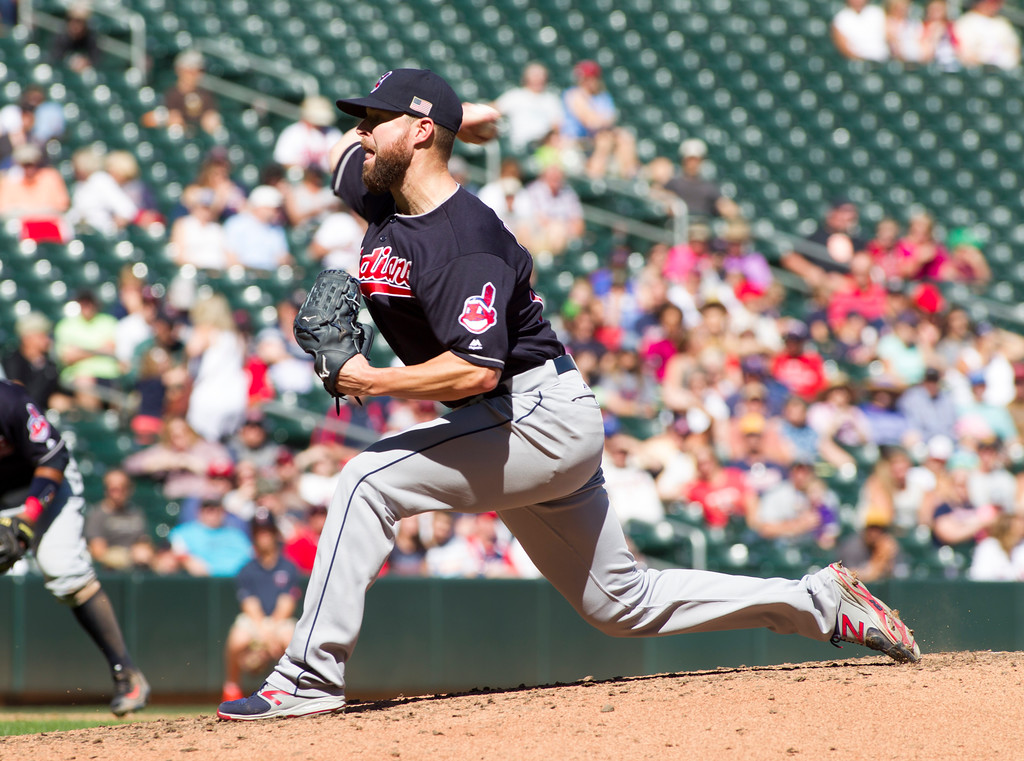 . Cleveland Indians starting pitcher Corey Kluber (28) delivers against the Minnesota Twins during a baseball game, Sunday, Sept. 11, 2016, in Minneapolis. (AP Photo/Paul Battaglia)