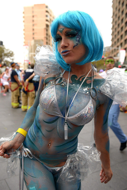 . Parade goers gather ahead of the start of the Gay and Lesbian Mardi Gras parade in Sydney, Saturday, Mar 1, 2014. (AAP Image/Dan Himbrechts)