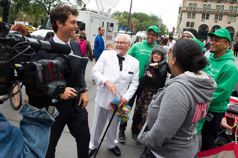 . In honor of Colonel Sanders\' birthday today, KFC surprised those waiting in line for the iPhone 6 with KFC chicken and the Colonel\'s signature string ties, on Tuesday, Sept. 9, 2014 in New York. (Photo by Charles Sykes/Invision for KFC/AP Images)