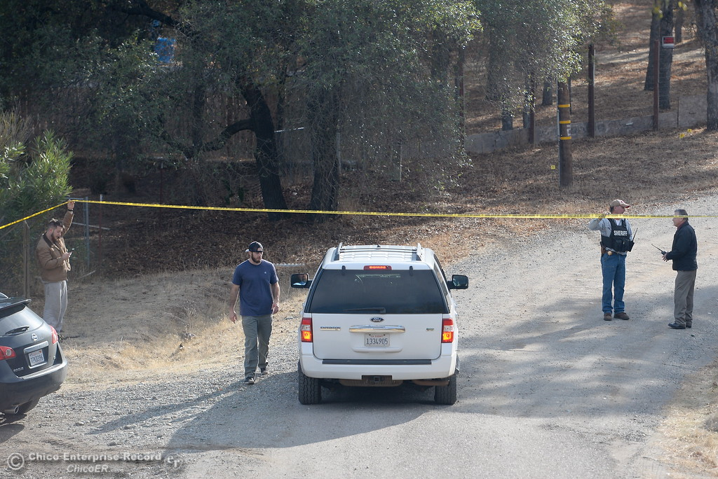 . A law enforcement vehicle makes it\'s way down Bobcat Lane in Rancho Tehama where several shootings occured in the community Tues. Nov. 14, 2017. Five people are dead including the shooter and ten people are injured. (Bill Husa -- Enterprise-Record)