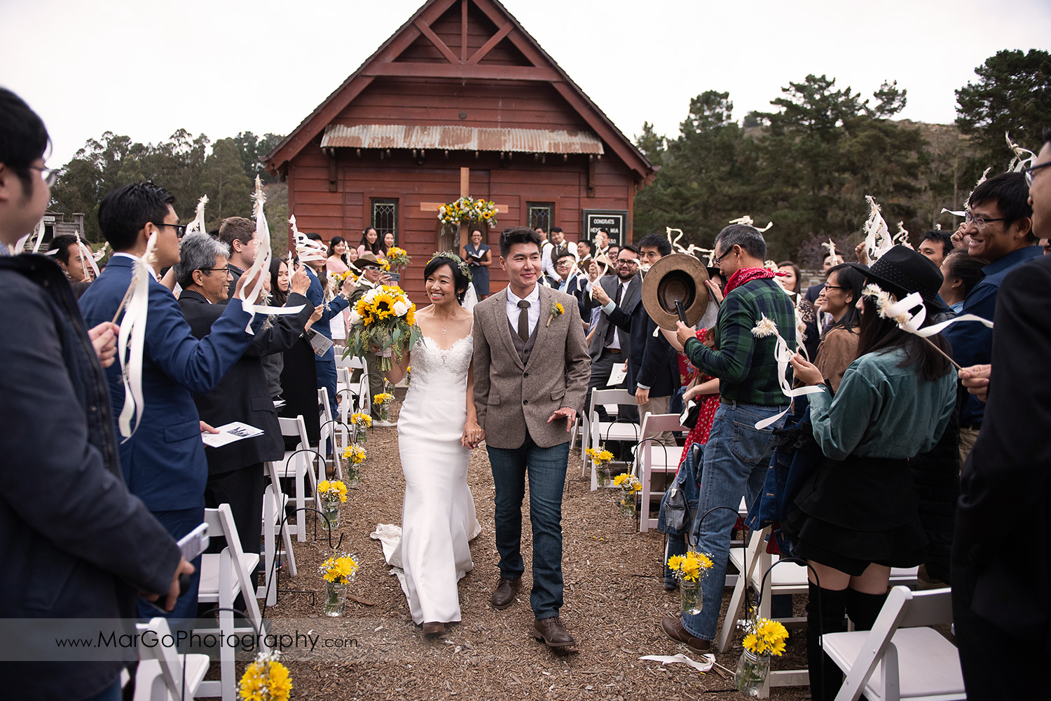 bride and groom walking down th aisle after wedding ceremony at Long Branch Saloon & Farms in Half Moon Bay
