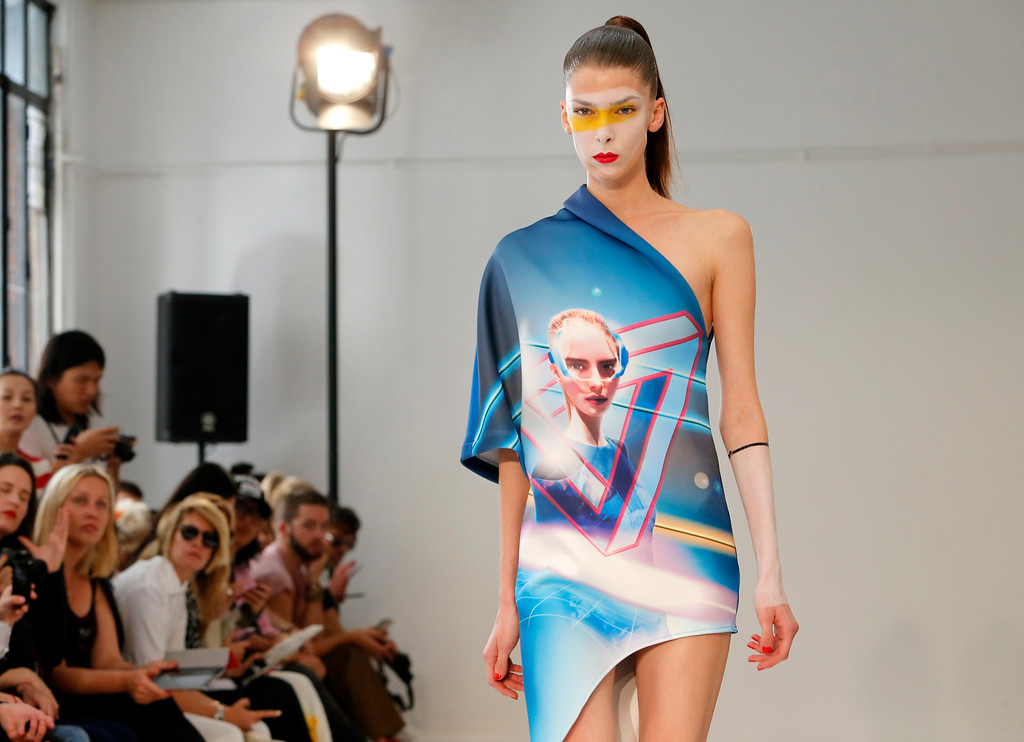 . A model presents a creation by fashion designers Eri and Philip Chu, from Hong Kong, for Ground Zero\'s ready-to-wear Spring/Summer 2014 fashion collection, presented in Paris, Tuesday, Sept.24, 2013. (AP Photo/Jacques Brinon)