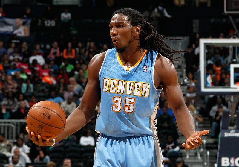. Kenneth Faried #35 of the Denver Nuggets reacts after drawing a foul against the Atlanta Hawks at Philips Arena on December 5, 2012 in Atlanta, Georgia.  (Photo by Kevin C. Cox/Getty Images)