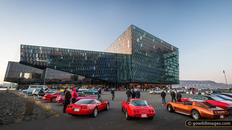 An informal car enthusiast gathering outside Harpa concert hall and entertainment venue