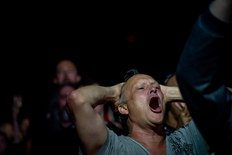 A fan, on the verge of tears, watches as Judas Priest performs the final song.