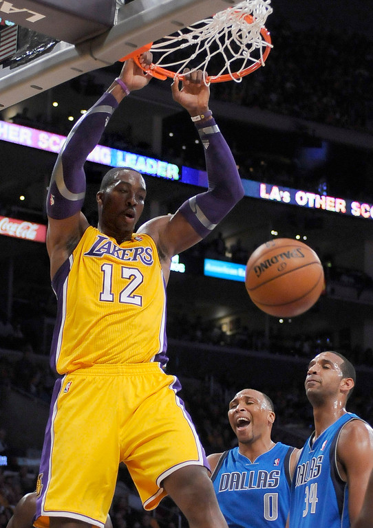 . Lakers #12 Dwight Howard dunks in the first half of play. The Los Angeles Lakers hosted the Dallas Mavericks in the opening game of the 2012 2013 NBA Season. Los Angeles, CA 10/30/2012 (John McCoy/L.A. Daily News)