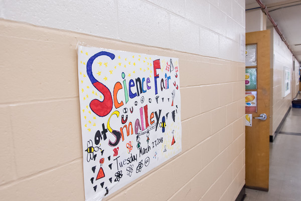 03/27/18 Wesley Bunnell | Staff Signs point to the location of the Smalley Academy 2nd Annual Smalley Science Fair on Tuesday morning featuring science exhibits by all grades.