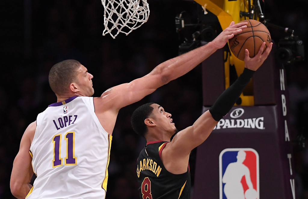 . Los Angeles Lakers center Brook Lopez, left, blocks the shot of Cleveland Cavaliers guard Jordan Clarkson during the second half of an NBA basketball game, Sunday, March 11, 2018, in Los Angeles. The Lakers won 127-113. (AP Photo/Mark J. Terrill)