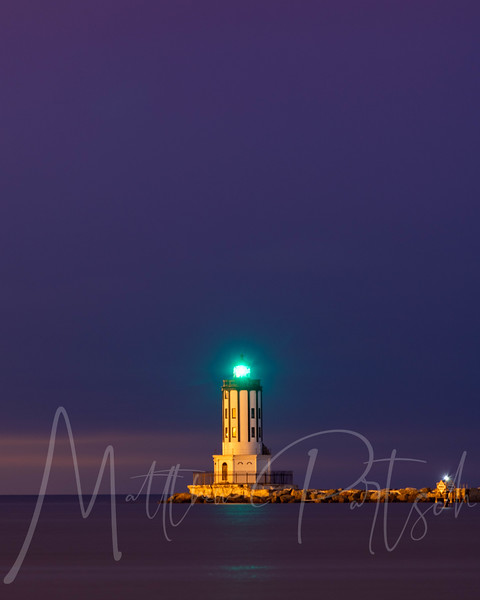 Strawberry Moon Rise directly behind the lighthouse - the soft glow of the moon broke through the clouds