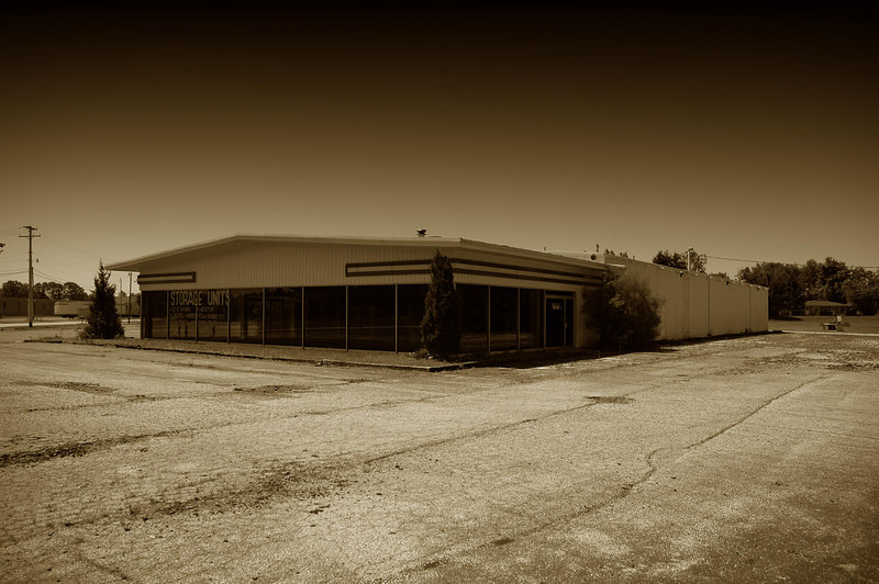 Empty auto dealership.  Most recently 'Whiteys Ford'