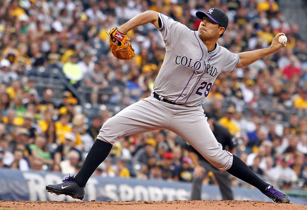 . PITTSBURGH, PA - JULY 18:  Jorge De La Rosa #29 of the Colorado Rockies pitches in the first inning against the Pittsburgh Pirates during the game at PNC Park on July 18, 2014 in Pittsburgh, Pennsylvania.  (Photo by Justin K. Aller/Getty Images)