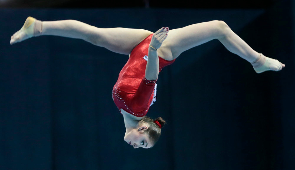 . Aliya Mustafina of Russia performs on the balance beam to win the women\'s All-Around Final of the Artistic Gymnastics European Championships in Moscow, Russia, Friday, April 19, 2013. (AP Photo/Mikhail Metzel)
