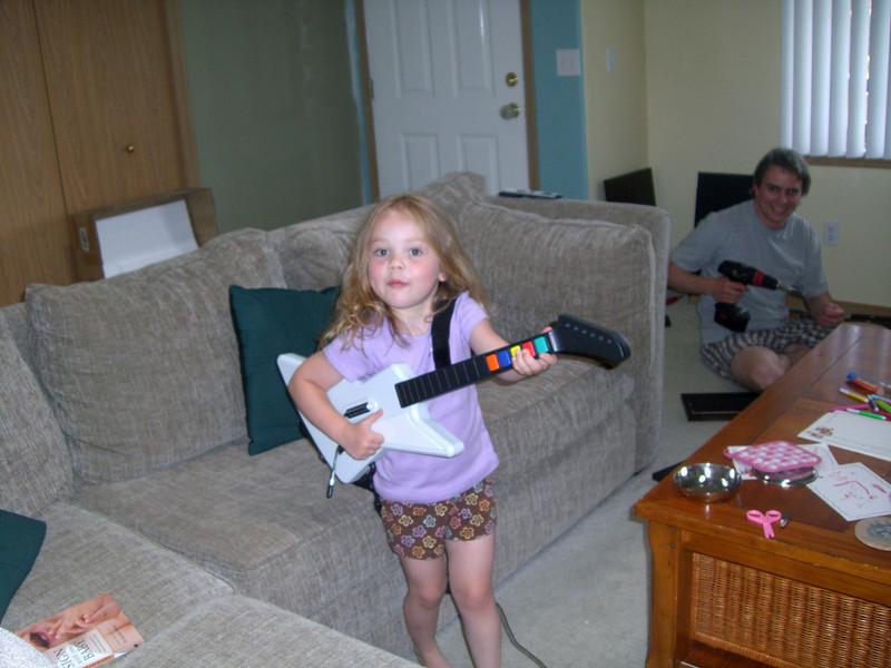 Playing guitar hero...kinda (while I put together night stands).