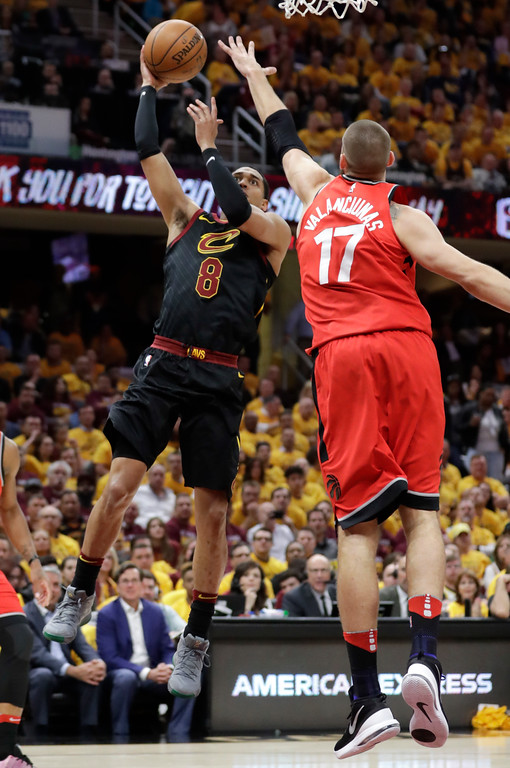 . Cleveland Cavaliers\' Jordan Clarkson (8) shoots over Toronto Raptors\' Jonas Valanciunas (17), from Lithuania, in the first half of Game 4 of an NBA basketball second-round playoff series, Monday, May 7, 2018, in Cleveland. (AP Photo/Tony Dejak)