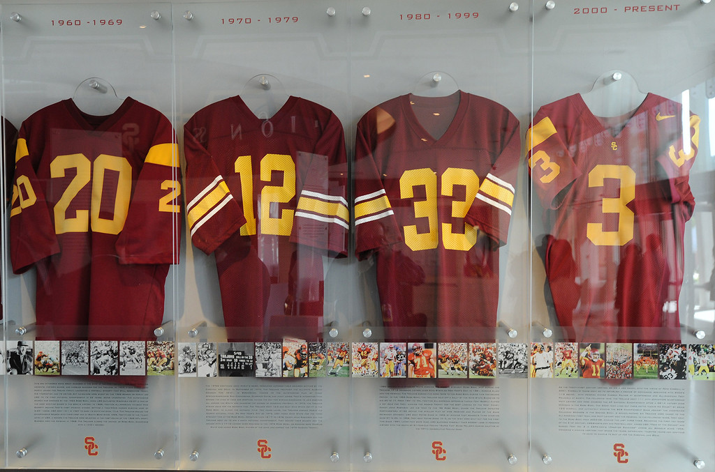 . A progression of football jerseys from 1960 to present. Heritage Hall, which houses USC\'s athletic department, has been closed for the past year while undergoing a $35-million renovation.  The building first opened in 1971 at a cost of $2.8 million and was originally 48,000 square feet. It now is 80,000 square feet. As part of the renovation, Heritage Hall\'s two-story lobby has been transformed into a state-of-the-art museum space featuring interactive displays. Heritage Hall also includes a sports performance center, a broadcast studio, a lounge for Women of Troy student-athletes, a rowing ergometer room and an indoor golf driving area, plus new locker rooms, meeting rooms, equipment room and event space.   Los Angeles , CA. January 30, 2014 (Photo by John McCoy / Los Angeles Daily News)