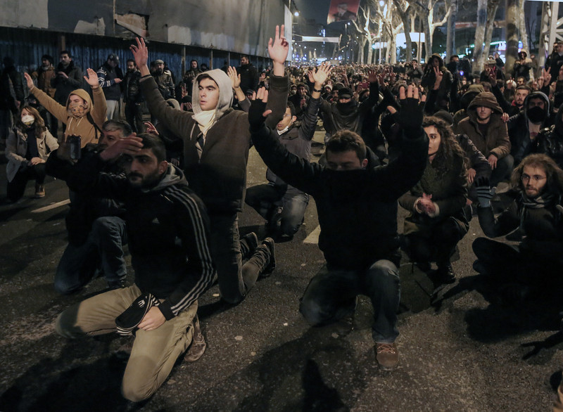 . People protest the death of Berkin Elvan, a Turkish teenager who was in a coma since being hit in the head by a tear gas canister fired by police during the summer\'s anti-government protests, in Istanbul, Turkey, Tuesday, March 11, 2014. The 15-year old Berkin Elvan�s death in an Istanbul hospital nine months after he fell into a coma looked likely to spark new protests in Turkey. Riot police fired tear gas, water cannon and rubber bullets to disperse anti-government protesters trying to converge in central Ankara and Istanbul hours after Berkin Elvan�s family announced his death. (AP Photo/Emrah Gurel)