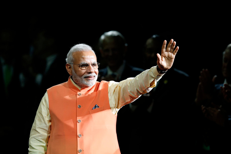 . Prime Minister Narendra Modi of India waves to the crowd as he arrives to give a speech during a reception by the Indian community in honor of his visit to the United States at Madison Square Garden, Sunday, Sept. 28, 2014, in New York. (AP Photo/Jason DeCrow)