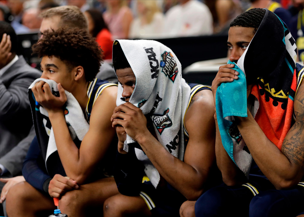 . Players on the Michigan bench watch during the second half in the championship game of the Final Four NCAA college basketball tournament against Villanova, Monday, April 2, 2018, in San Antonio. (AP Photo/Eric Gay)
