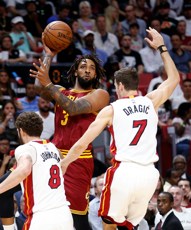 . Cleveland Cavaliers forward Derrick Williams (3) passes past Miami Heat guard Tyler Johnson (8) and guard Goran Dragic (7) during the first half of an NBA basketball game, Monday, April 10, 2017, in Miami. (AP Photo/Wilfredo Lee)