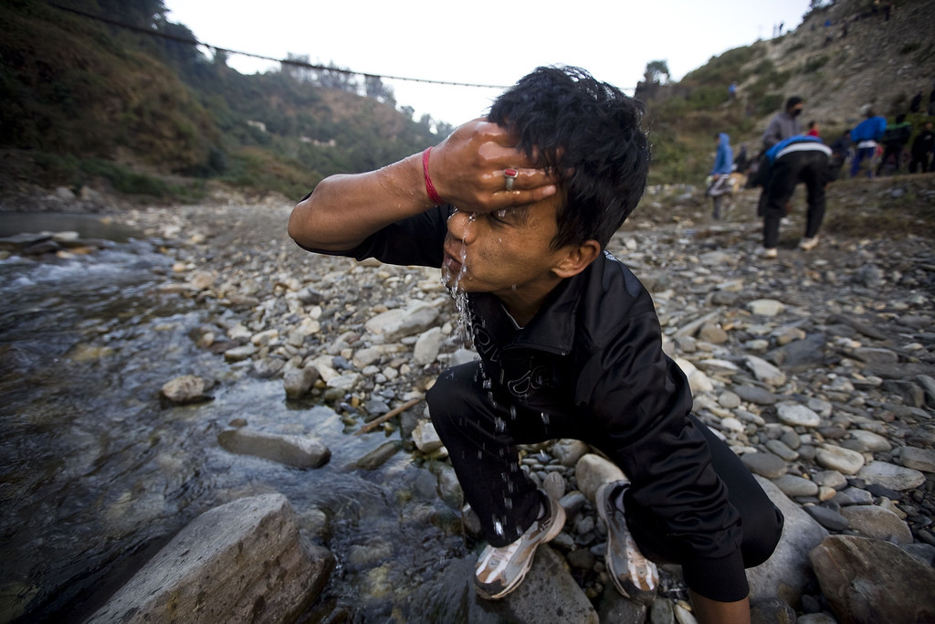 . A Nepalese man wash his face after completing a high hill race as part of a physical training session, organized by a private institute in Phokhara who prepares them for the British Gurkha soldier recruitment selection, at Malam Mountain in Kaski district, Nepal, 18 November 2012. The British Gurkha soldier recruitment selection process started on 23 November and runs untill the end of December 2012 at British Gurkha camp situated in Pokhara City, Nepal. Around 125 youths will be selected from more than three thousands participants. Those selected will join the British Army, a selection which carries much prestige and admiration throughout Nepalese society.  EPA/NARENDRA SHRESTHA