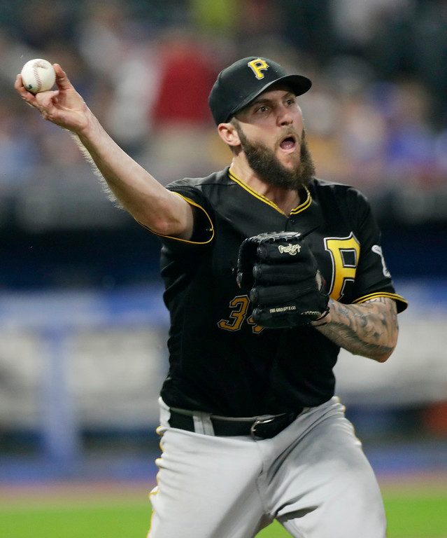 . Pittsburgh Pirates starting pitcher Trevor Williams throws to first base but not in time to get Cleveland Indians\' Jason Kipnis in the fifth inning of a baseball game, Monday, July 23, 2018, in Cleveland. (AP Photo/Tony Dejak)
