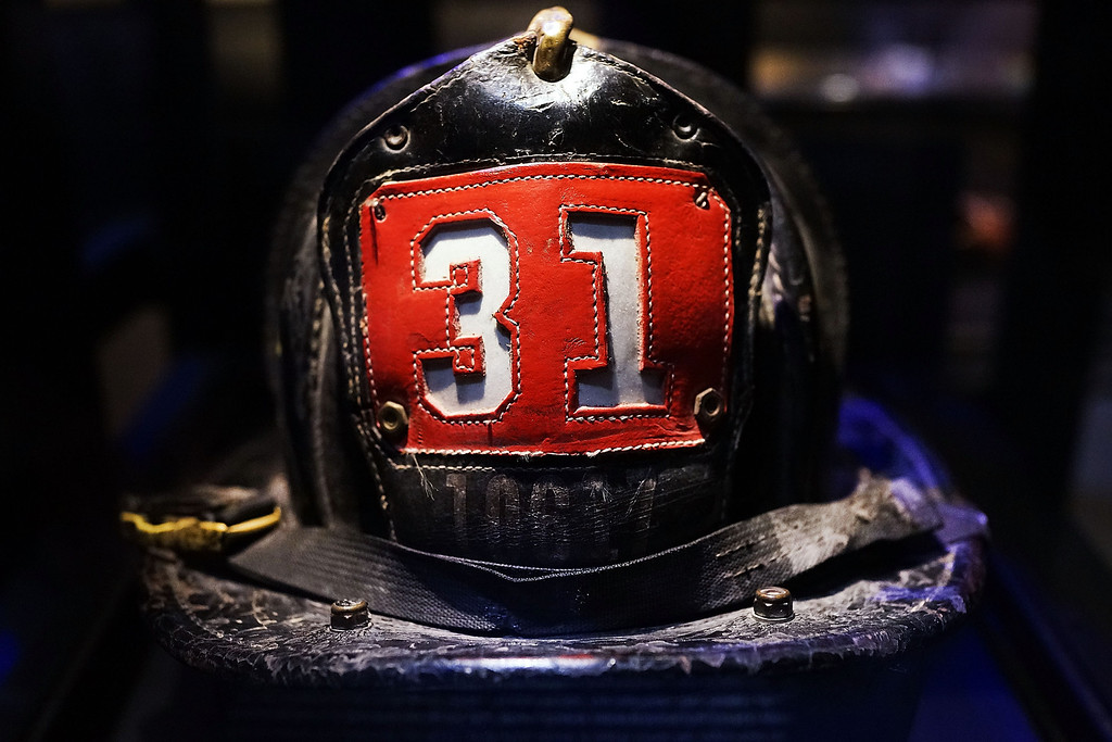 . Surviving firefighter Dan Potter\'s fire helmet, which he used at Ground Zero on September 11, is viewed during a tour the National September 11 Memorial Museum on May 14, 2014 in New York City.   (Photo by Spencer Platt/Getty Images)