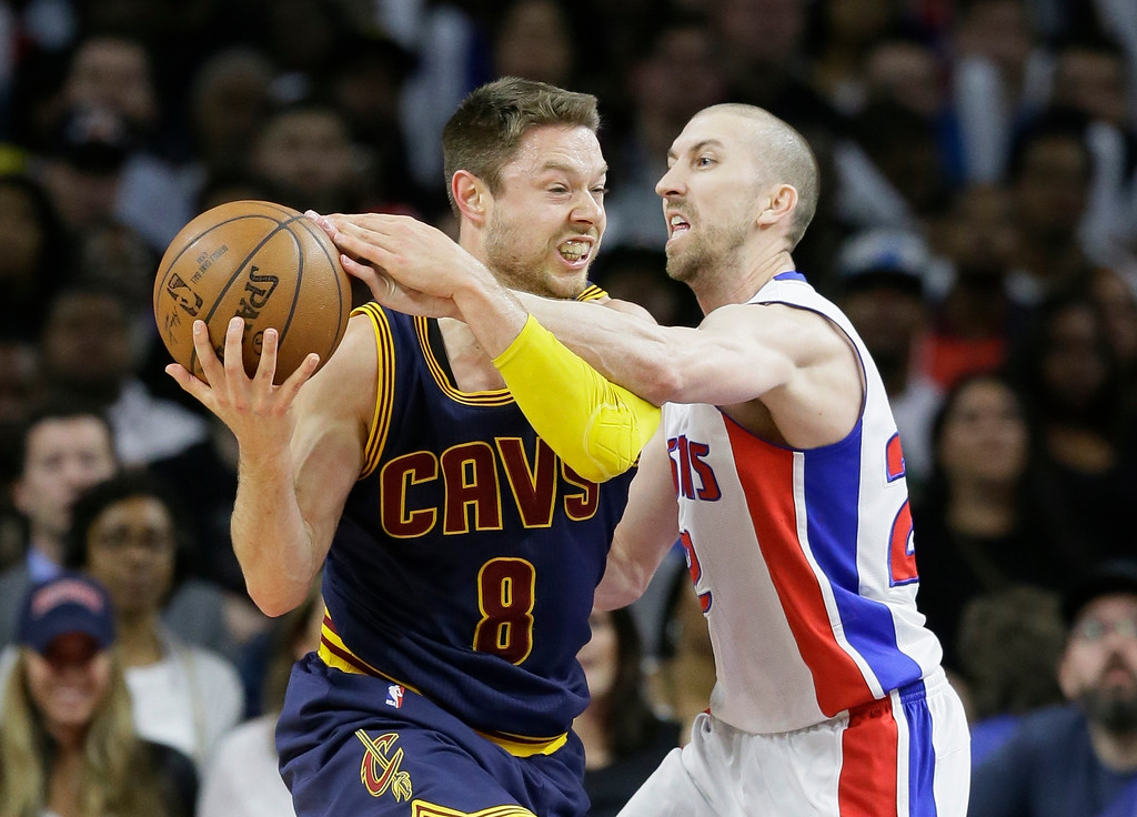 . Detroit Pistons guard Steve Blake (22) reaches in on Cleveland Cavaliers guard Matthew Dellavedova (8) during the second half in Game 4 of a first-round NBA basketball playoff series, Sunday, April 24, 2016 in Auburn Hills, Mich. The Cavaliers defeated the Pistons 100-98 and swept the series. (AP Photo/Carlos Osorio)