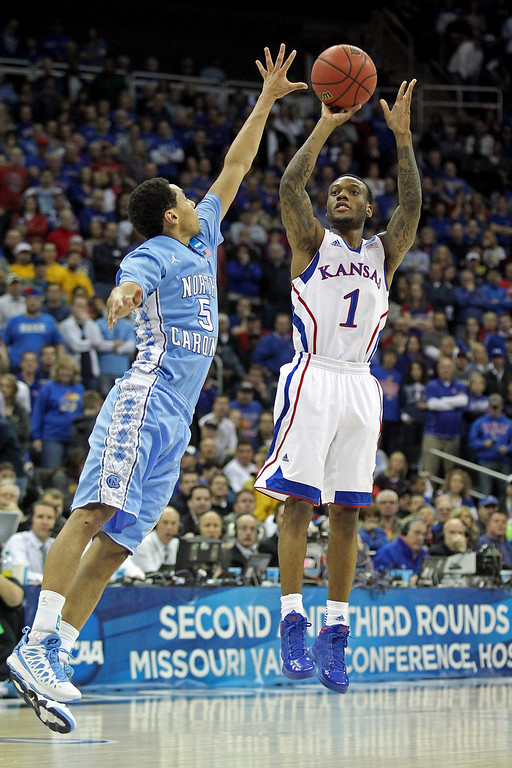. Naadir Tharpe #1 of the Kansas Jayhawks attempts a shot in the first half against Marcus Paige #5 of the North Carolina Tar Heels during the third round of the 2013 NCAA Men\'s Basketball Tournament at Sprint Center on March 24, 2013 in Kansas City, Missouri.  (Photo by Ed Zurga/Getty Images)