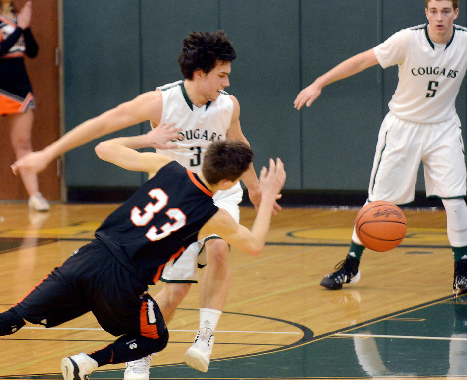 . Maribeth Joeright/MJoeright@News-Herald.com<p> Chagrin\'s Nate Diedrich and Lake\'s Brett Nalepa chase a loose ball in the fourth quarter of the Division II district final game, March 8, 2014 at Lakeside High School.