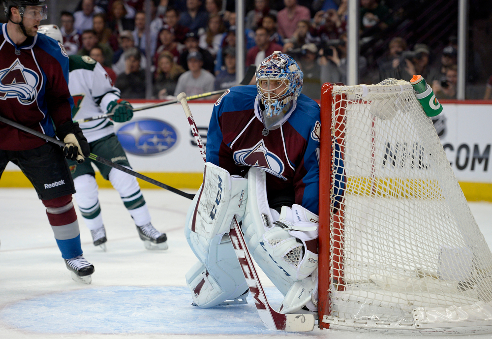 . Semyon Varlamov (1) of the Colorado Avalanche keeps an eye on the puck during the second period of action. The Colorado Avalanche hosted the Minnesota Wild for the first playoff game at the Pepsi Center on Thursday, April 17, 2014. (Photo by John Leyba/The Denver Post)