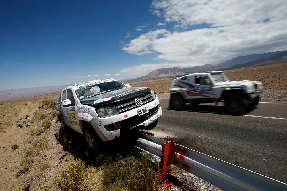 . A support vehicle crashes on a road barrier at the highlands of Chile en route to the Jama border crossing during the untimed 7th stage of the Dakar Rally 2013 from Calama to Salta, January 11, 2013. REUTERS/Ivan Alvarado