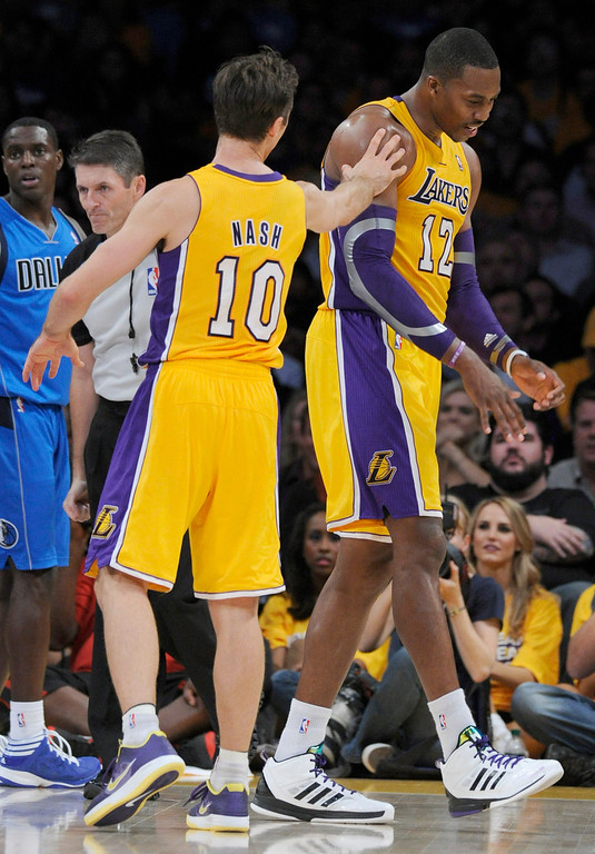 . Lakers Steve Nash consoles Dwight Howard after his 5th foul. Howard would eventually foul out of the game. The Los Angeles Lakers lost to the Dallas Mavericks 99-91 in the opening game of the 2012-2013 NBA Season. Los Angeles, CA 10/30/2012 (John McCoy/L.A. Daily News)