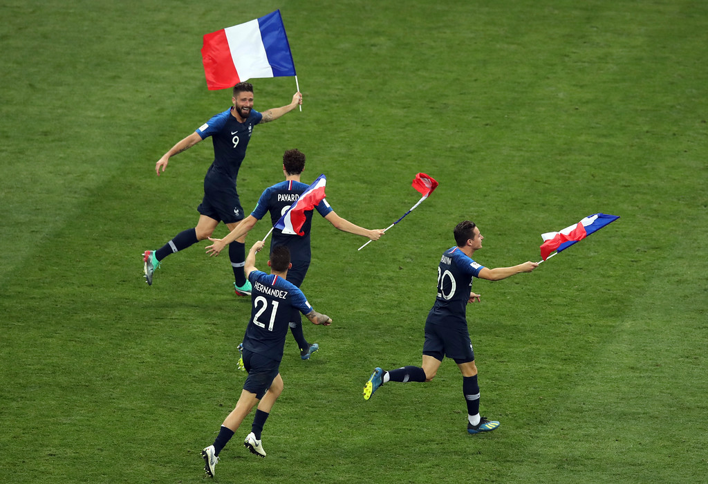 . France\'s Olivier Giroud, left, and his teammates celebrate at the end of the final match between France and Croatia at the 2018 soccer World Cup in the Luzhniki Stadium in Moscow, Russia, Sunday, July 15, 2018. (AP Photo/Thanassis Stavrakis)