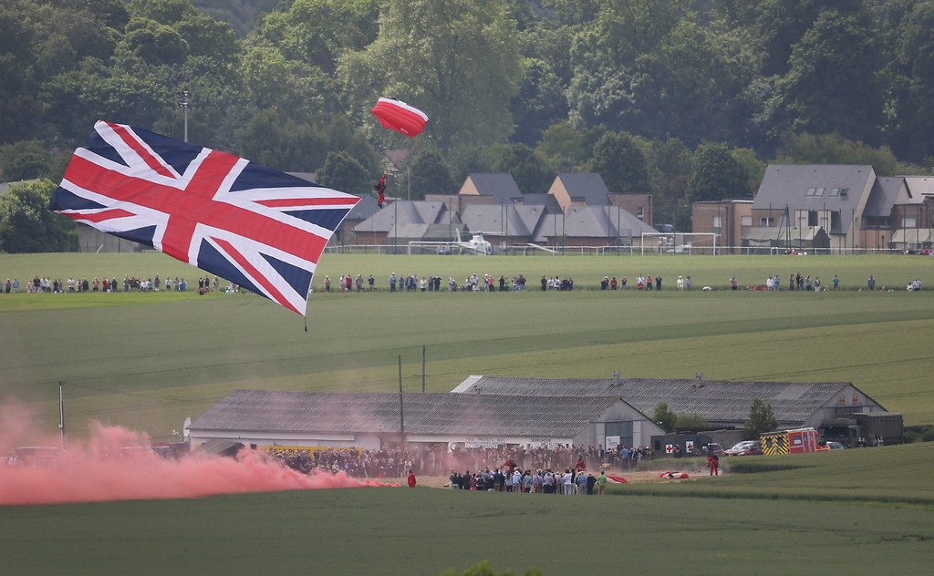 . The British Army Red Devils parachute display team appear on June 5, 2014 near Ranville, France.   (Photo by Peter Macdiarmid/Getty Images)