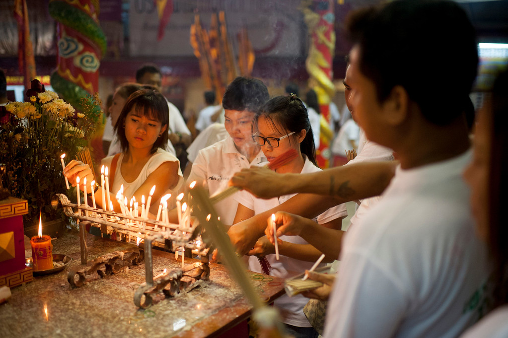 . Vegetarian festival devotees offer prayers at the Bang Neow shrine before a climbing on blades stairs performance on September 30, 2014 in Phuket, Thailand.  (Photo by Borja Sanchez-Trillo/Getty Images)