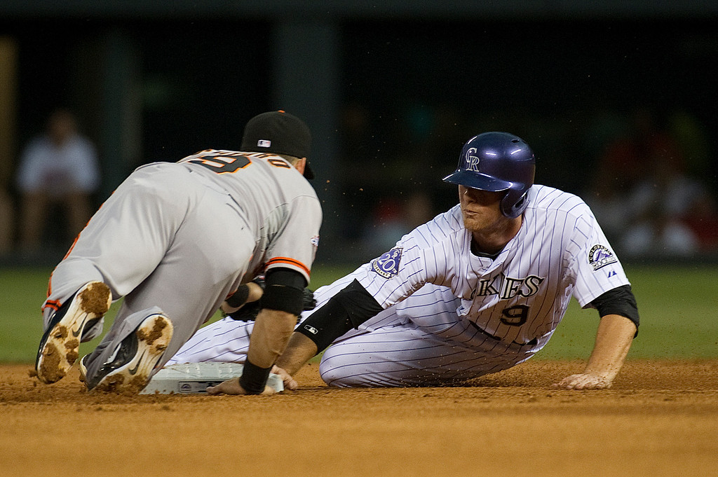 . DENVER - JUNE 28: DJ LeMahieu #9 of the Colorado Rockies races to second against Marco Scutaro #19 of the San Francisco Giants on June 28, 2013 at Coors Field.  (Photo By Grant Hindsley / The Denver Post)