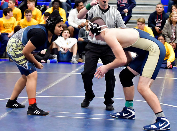 12/15/2018 Mike Orazzi | Staff Newington Wyatt Bernard and East Haven's Jesse Quinto in a 220 match during the Plainville Invitational Wrestling Tournament Saturday.