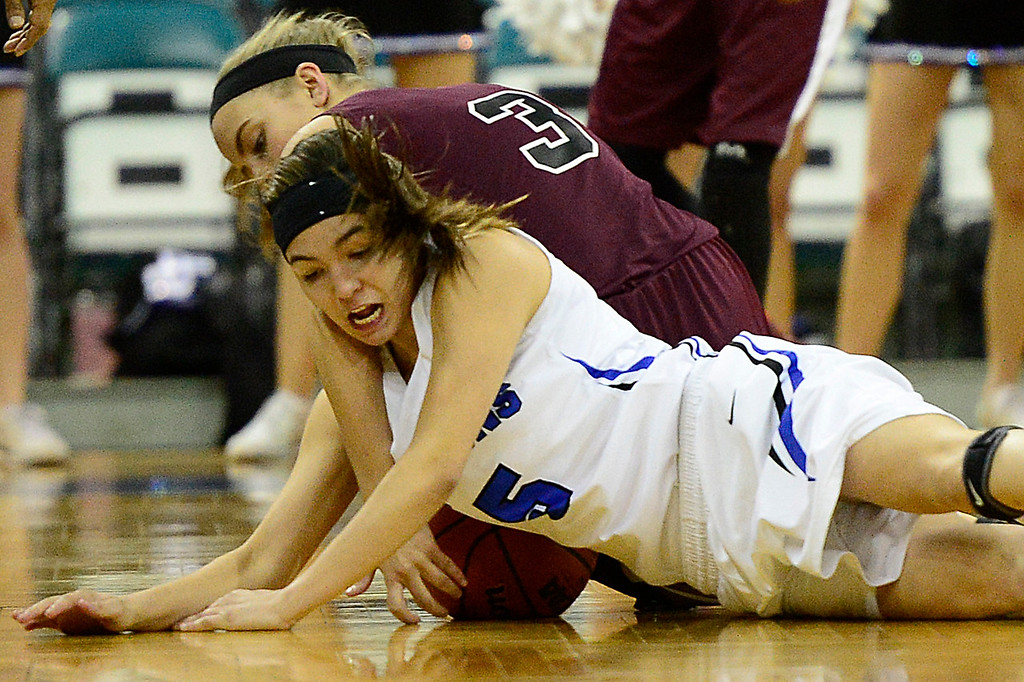 . Highlands Ranch guard Tommi Olson battles for the ball with Horizon guardJordan Matthews (5) during the second quarter at the Pepsi Center on March 4, 2016 in Denver, Colorado. Highlands Ranch defeated Horizon 65-35 to advance to the semifinals of girls 5A basketball tournament. (Photo by Brent Lewis/The Denver Post)