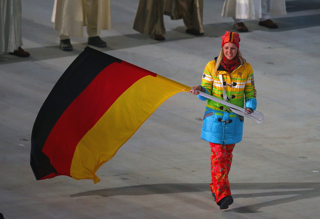 . Alpine skier Andrea Rothfuss of Germany bears the flag during the Opening Ceremony of the Sochi 2014 Paralympic Winter Games at Fisht Olympic Stadium on March 7, 2014 in Sochi, Russia.  (Photo by Hannah Peters/Getty Images)