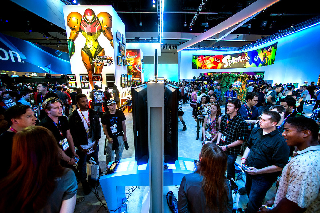 ". Attendees play the Nintendo ""Super Smash Bros\"" video game at at the Electronic Entertainment Expo in Los Angeles on Tuesday, June 10, 2014. (Photo by Watchara Phomicinda)"