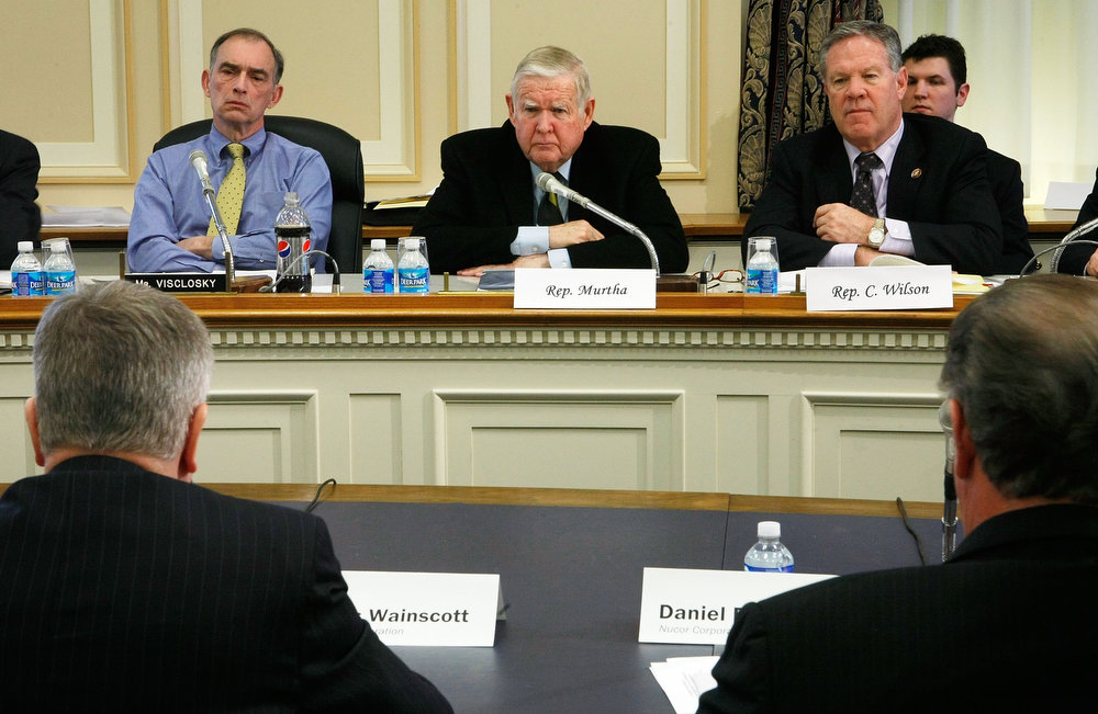 . (L-R) Caucus Chairman Rep. Peter Visclosky (D-IN), Rep. John Murtha (D-PA), and Rep. Charles Wilson (D-OH) listen to testimonies during a hearing before the Congressional Steel Caucus on Capitol Hill February 4, 2009 in Washington, DC. The hearing was to examine the state of the steel industry in the United States of America. Former Rep. Charlie Wilson (D-OH),  70, died in hospital on April 14, 2013 in Boynton Beach, Florida.  (Photo by Alex Wong/Getty Images)